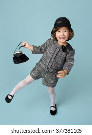 Child and kids fashion and clothing: girl in modern outfit on blue background