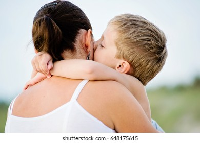 child kisses mother