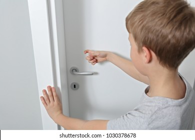 Child knocking on door before entering, home privacy concept