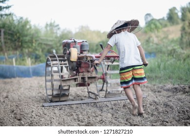 Child labor, Poor children driving a plow farming area, Children have to work because of poverty, Agriculture, World Day Against Child Labour concept.