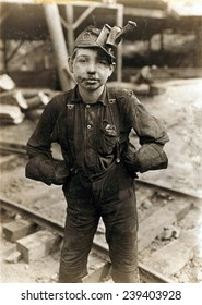 Child laborer portrayed by Lewis Hine in 1908. Tipple Boy at West Virginia coal mine, worked with the tipple, a device that tilted coal cars from the mine for unloading.