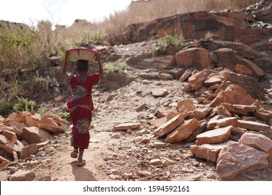 Child Labour issues, Human Rights Little African Girl Working for her Family