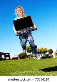Child with laptop.
