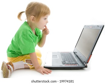 child with laptop hold finger on lips think on white background