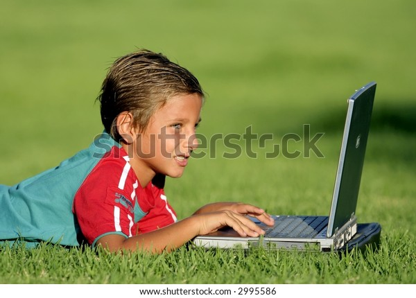 Child with laptop outdoor