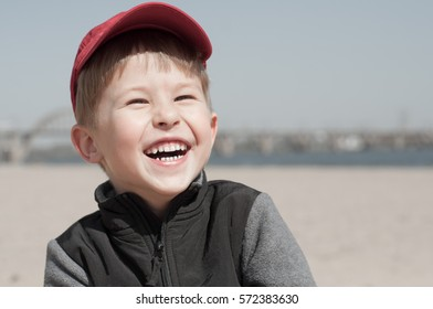 Child is laughing at beach