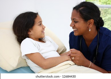 Child laying sick in bed at the hospital
