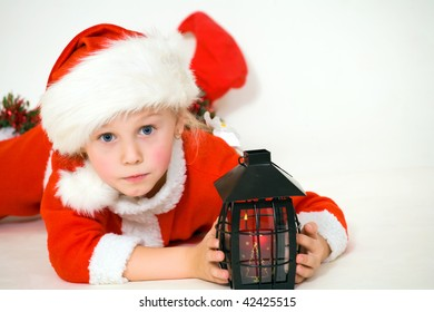 The child lays in dress Santa on a white background