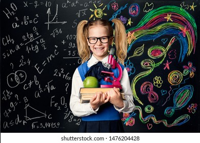 Child Learning Creativity and Mathematics, Creative School Kid Girl Student with Books over Art Blackboard, Education Concept