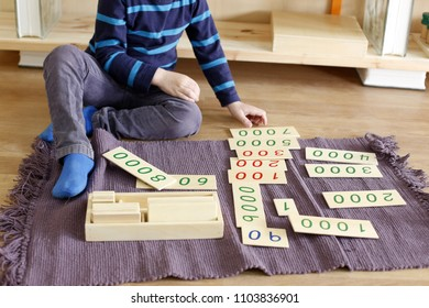 Child learning with montessori material