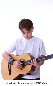 a child learning to play the acoustic guitar.