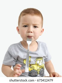 child learns to eat with a fork and spoon