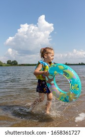 child learns to swim. child swims in a swimming circle
