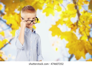 Child with leaves background.