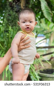 child lies and starts to babble, 7 months old asian baby boy,baby talk