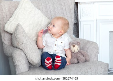 Child. Little boy at home in the room.. Child sits in a chair. First year of life