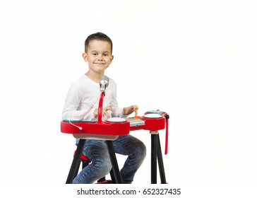 Child little boy playing on a toy piano