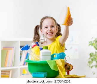Child little girl cleaning at home