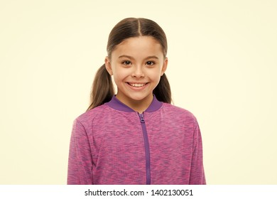 Child long hair happy smiling. Happy childhood concept. What is difference between phony and sincere smile. Girl cute child happy smiling face. What science has to say about genuine and fake smiles.