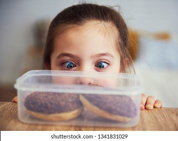 Child looking at delicious donuts