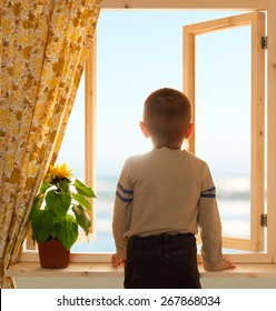 child looking through open window wooden sea sky view