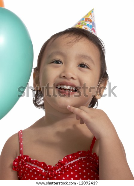 child looking up wearing a party hat
