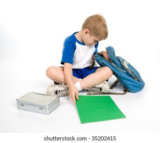 A child looks in his backpack as he gets out his homework.