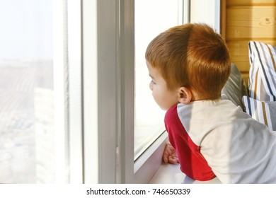 child looks out the window