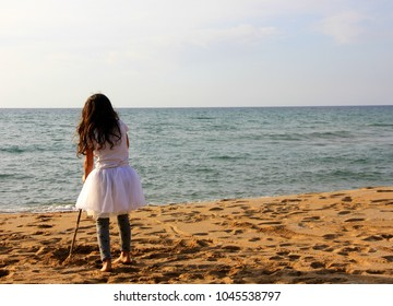 child looks at the sea