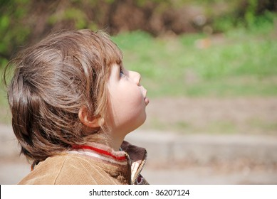 A child looks up, emotional face