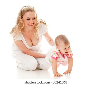 Child and loving mother; child steps on her hands