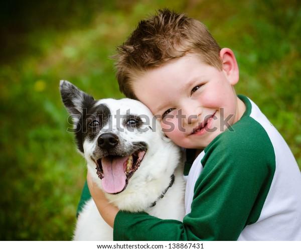 child-lovingly-embraces-his-pet-600w-138