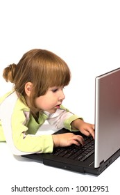 Child lying on the floor and typing message from laptop isolated on white