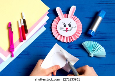 Child makes bunnies out of paper for Easter decoration. Creative idea for children's party. DIY concept. Step by step photo instruction. Step 13. Cut circle