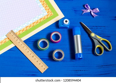 Child makes card with 3D gifts for Christmas. Children's art project. DIY concept. Step by step photo instruction. Step 1. Preparation of materials and tools