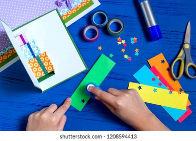 Child makes card with 3D gifts for Christmas. Children's art project. DIY concept. Step by step photo instruction. Step 10. Cut stars