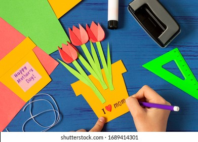 Child makes card for Mother's Day. Children's craft during quarantine. How to captivate children at home during COVID-19 coronavirus pandemic. Step-by-step photos. Step 10. Stick tulips