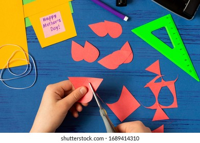 Child makes card for Mother's Day. Children's craft during quarantine. How to captivate children at home during COVID-19 coronavirus pandemic. Step-by-step photos. Step 7. Cut petals