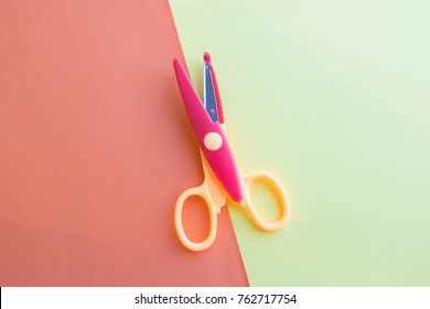 The child makes decoration. scissors, colored paper. art project, a craft for children
