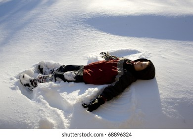 A child makes a snow angel