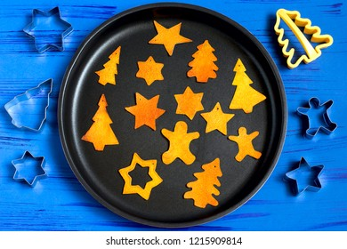 Child making decorations of orange peel for Christmas. Children's art project. DIY concept. Step by step photo instruction. Step 5. Dry completely on baking sheet