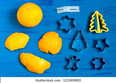 Child making decorations of orange peel for Christmas. Children's art project. DIY concept. Step by step photo instruction. Step 1. Preparation of materials and tools