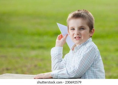 child making a paper airplane