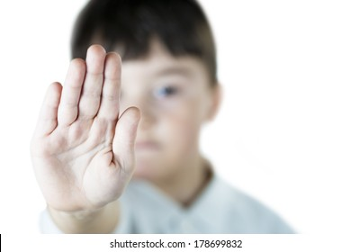 A child making s stop gesture with his hand