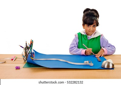 Child is making a school project using ruler and pencil on isolated white background