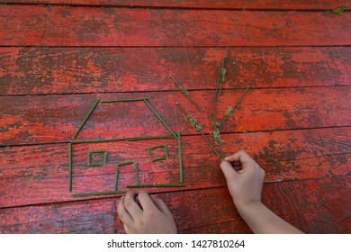 the child making some shapes or house with green rods on the colorful table for school art lesson activity time.