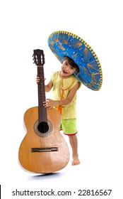Child with Mexican hat playing guitar