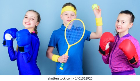 Child might excel completely different sport. Sporty siblings. Girls kids with boxing sport equipment and boy tennis player. Ways to help kids find sport they enjoy. Friends ready for sport training.