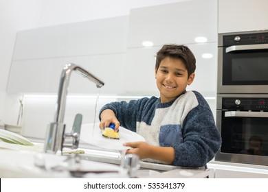 Child in modern white kitchen