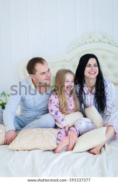 Child Mom Dad Sit On Bed Stock Photo Edit Now 591537377